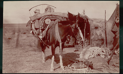 Woman's Horse, Saddled and Loaded with Articles for Travel Including Infant Cradle, Outside Toldo (Skin and Pole Tents); Saddle on Ground FEB 1898