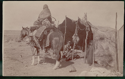Woman in Costume and on Horseback with Articles for Travel, Including Infant Cradle, Non-Indian Man, Trader, Drinking Yerba Mate and with Two Young Girls Inside Toldo (Skin and Pole Tent); Bola, Horse Trappings and Drying Meat on Poles FEB 1898