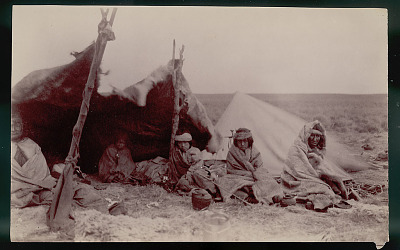 Group in Costume Outside Toldo (Skin and Pole Tents); Metal Teapots Nearby 1898