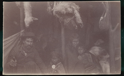 Non-Indian Man, Trader, and Woman with Young Boy and Girl in Costume Inside Toldo (Skin and Pole Tent); Dead Guanaco Hanging On Pole 1898