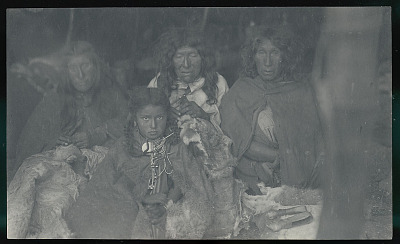 Three Old Women and Young Girl in Costume with Scrapers, Dressing and Sewing Guanaco Skins Inside Toldo (Skin and Pole Tent) FEB 1898