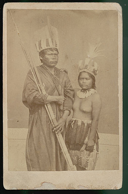 Portrait of Man with Bow and Arrows, and with Woman; Both From Ucayali River and Both Wearing Face Paint and in Costume With Feather Headdresses 16 SEP 1871