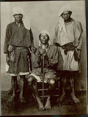 Portrait of Three Men from Mahuala, Solola? in Costume, One With Cane of Office n.d