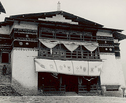 Stone and Wood Gompa (Sacred Library) with Curtain Over Entrance Portraying Eight Auspicious Emblems of Buddhism 1954