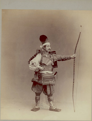 Portrait of Archer, in Costume and Armor with Bow, Quiver, Swords, and Fan 1880