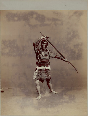Portrait of Sword Spearman in Costume and Armor with Spear With Long Curved Blade n.d