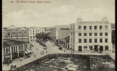 View of Business District Showing Chinese Shops, Bank, and Group in Street with Jinrikshas n.d