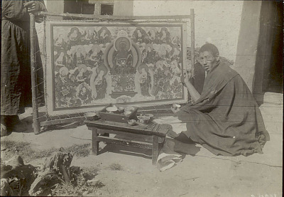 Man Wearing Glasses and in Costume, Painting Temple Banner On Wood Frame; Wood Bench with Porcelain Bowls of Paint Nearby, Outside Masonry Building 1914