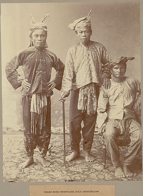 Portrait of Three Men (Chiefs) in Costume, One Holding Cane 1902