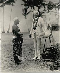Hiram Bingham and unidentifed Samoan man Near Round Pole and Thatch House ca. 1930