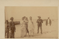 Angola Man with Women in Costume on Beach; Boat Nearby DEC 1889