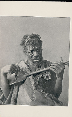Man in Costume, Playing Two Stringed Instrument n.d