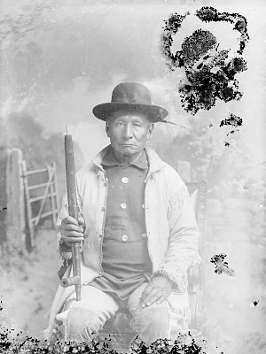 Chief White Horse? in Partial Native Dress and Holding Pipe n.d