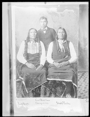 Portrait of Left Hand and Short Teeth, Both in Partial Native Dress and Wearing Hair Pipe Ornaments and with Carl Matches From Cheyenne Reservation 1879