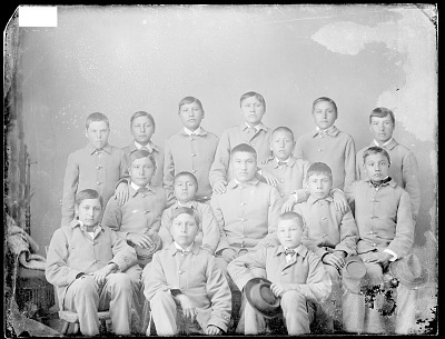 Portrait of Group of Male Students, from Pine Ridge Reservation, South Dakota, in School Uniform 1894
