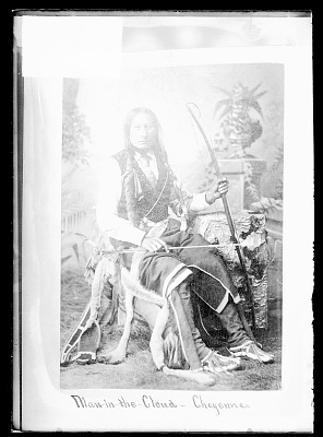 Photo of Portrait of Chief Man-In-The Cloud in Partial Native Dress and with Fur-Wrapped Braids, Bow, Arrow, and Quiver 1879