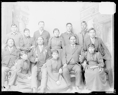Portrait of Non-Native Man with Three Visiting Chiefs and Group of Students in School Uniform; Chiefs with Canes MAY 1893
