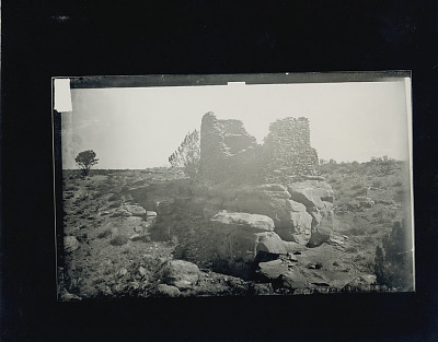 Two-room masonry ruins atop rock, possibly used as an outlook for fields near lake 1882