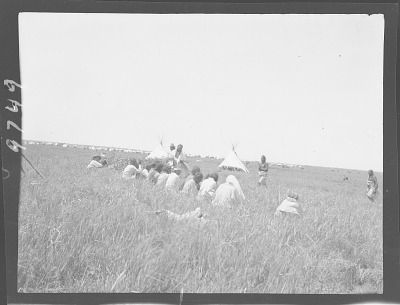 Indians seated on ground. Oklahoma. A group of Sun Dance priests (?) 1903