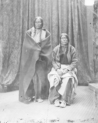 Portrait of Old Wolf and Lame White Man, Both in Partial Native Dress 1868