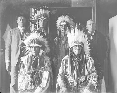 Group Portrait of Six Men, One Non-native AUG 1907