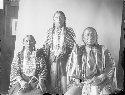 Portrait of Aquqavenuts (Crossed Feathers) or (Messed-Up Feathers) with Wife and Daughter JUN 1908