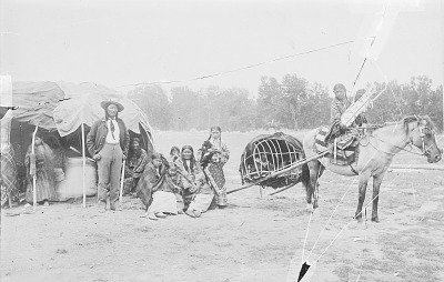 Stump Horn, Scout For Lt Edward Casey, with His Family, All in Partial Native Dress, Woman Holding Child in Cradleboard On Horse with Travois 1903