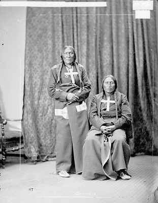 Portrait of Little Robe and White Horse, Both in Partial Native Dress with Cross Necklaces 1871