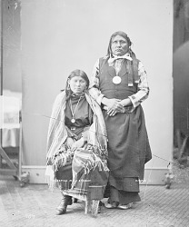 Portrait of Gui-Kati (Sleeping Wolf) with His Wife, Both in Partial Native Dress with Ornaments, He with Peace Medal 1872
