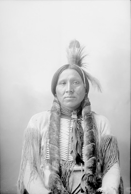 Portrait (Front) of Man in Native Dress with Breastplate and Headdress 1898