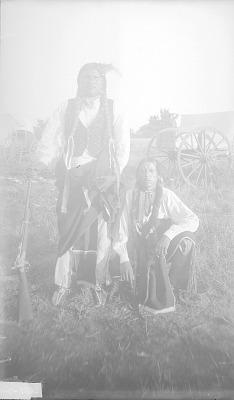 Kiowa Jim with his Brother-In-Law, Haumpy with Ornaments, One Holding Rifle 1892