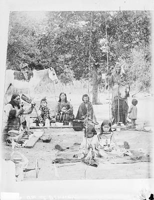 Gaapiatan (Haitseke) Holding Lance with Family at Dinner? 1891