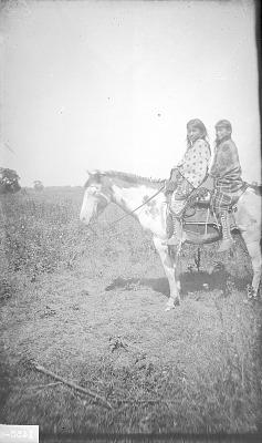Kiowa girls on horseback, Kiowa Reservation, Oklahoma 1892