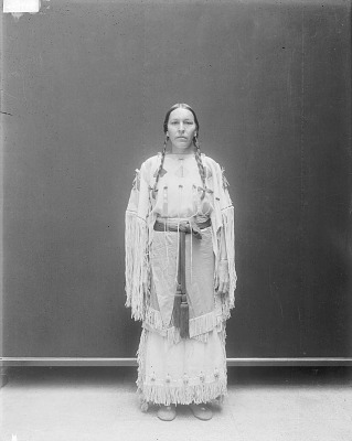 Portrait (Front) of Wife of Emhaua (Rescuer) in Self-Made Native Dress with Ornaments MAR 1913
