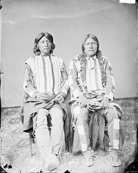 Portrait of Kwa-Ko-Nut (A King) and with Mose, Both in Native Dress with Breastplates, One Holding Pistol 1873
