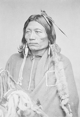 Portrait of Chief Pacer with Fur-Wrapped Braids, Wearing Blanket and Ornaments and Holding Bow in Case and Fur Quiver 1867-75