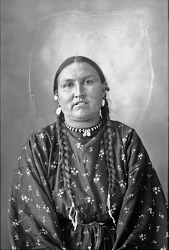 Portrait (Front) of Chief Wets It from Fort Peck Reservation, Leader of Assiniboin Delegation to Exposition, in Partial Native Dress with Shell Gorget and Button 1898