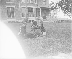 [Three Winnebago women on the lawn of Dr. Gebhardt's house] ca. 1900