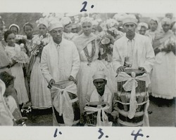 [Three drummers, Antonia, and other filhas standing before Sabina's house for Sabina's presente to Iemanjá], 1938 September 11