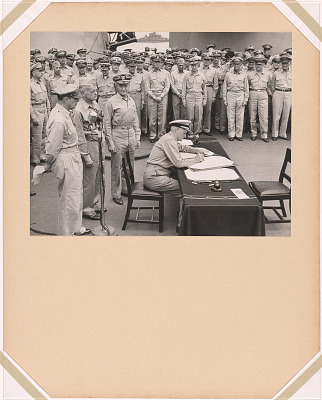 Admiral Nimitz signing the Instruments of Surrender aboard the USS Missouri
