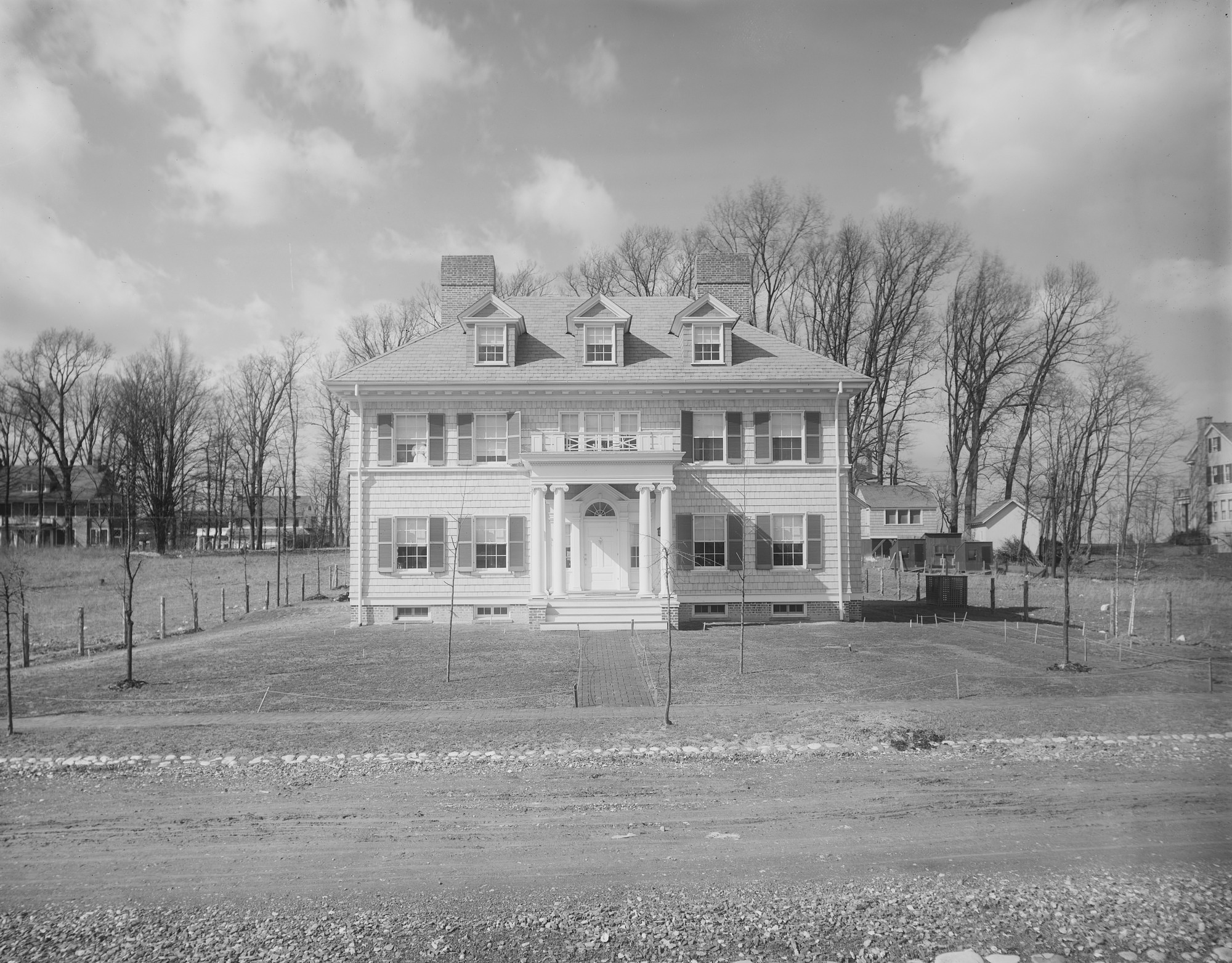[Ogilby Garden]: front of house, with an unpaved Primrose Street in the foreground.