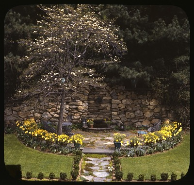 [Ferncote] [slide]: wall fountain with potted plants and tulips