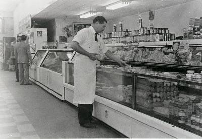 Louis Menotti at semi-self-service counter, first in Galveston, 1949, from