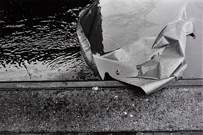 Untitled (water, paper, curb)