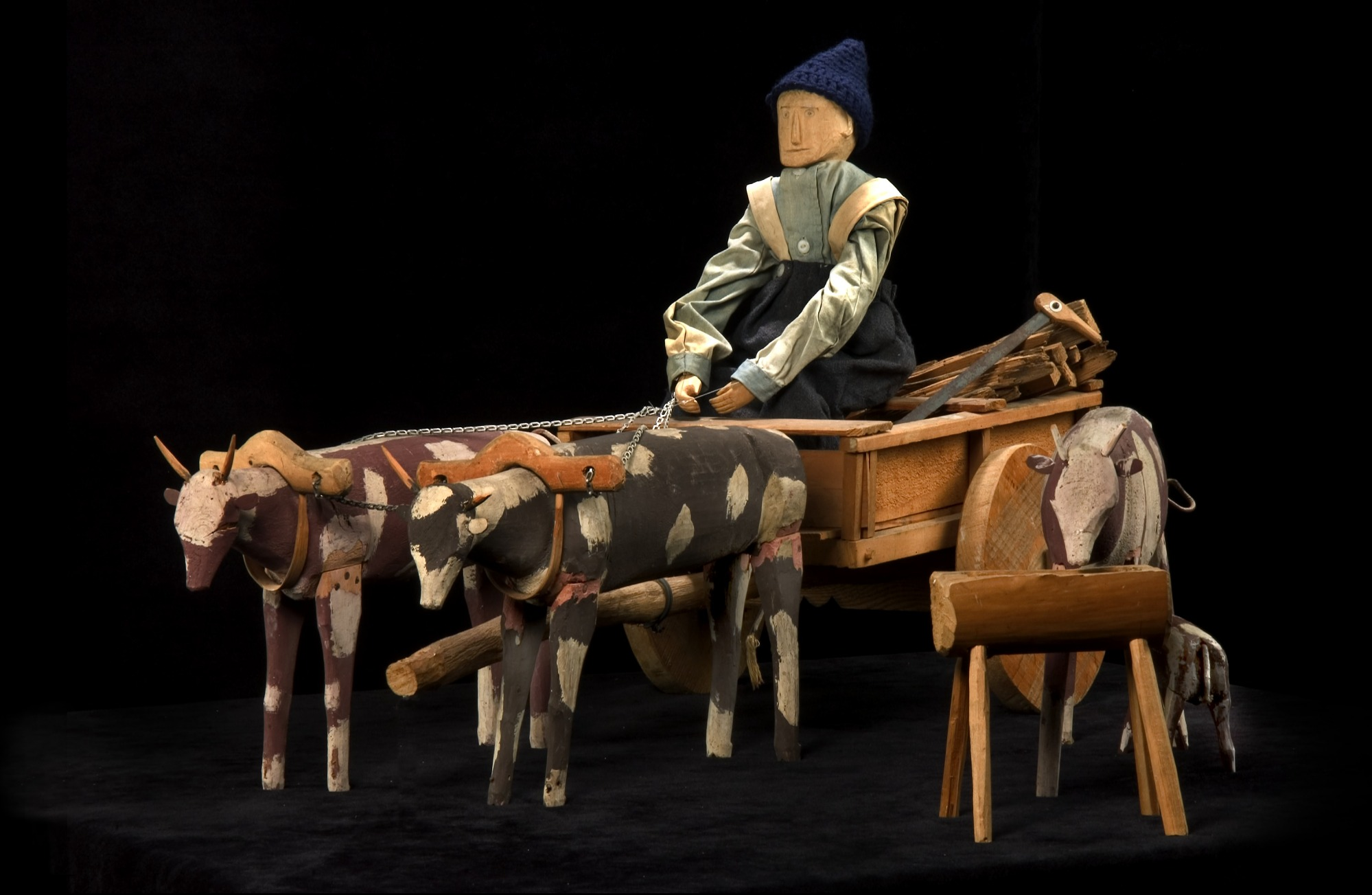 Man, Ox-drawn Cart with Logs and Saw, Cow, Calf and Trough