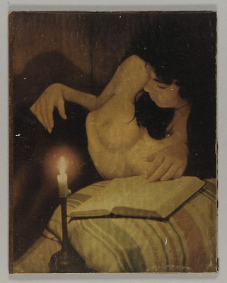 Untitled (reclining nude reading by candlelight)