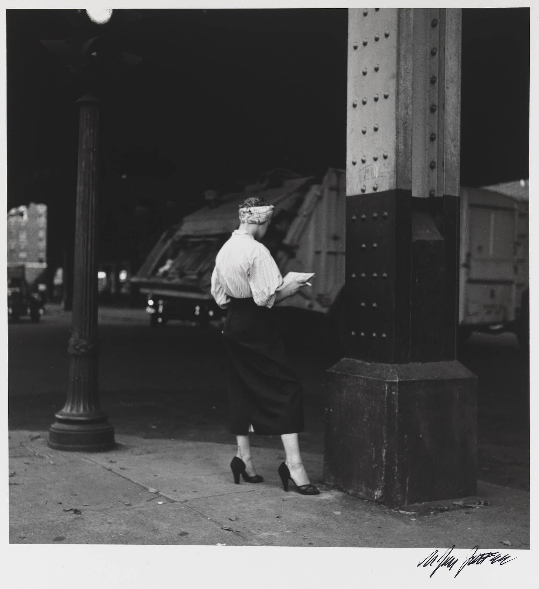 images for Woman Reading Paper Under the El