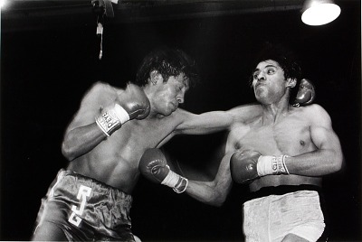 Two unidentified boxers sparring in ring