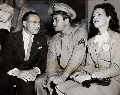 Barney Ross (center) as Sergeant with wife (right) and R. F. Nelson