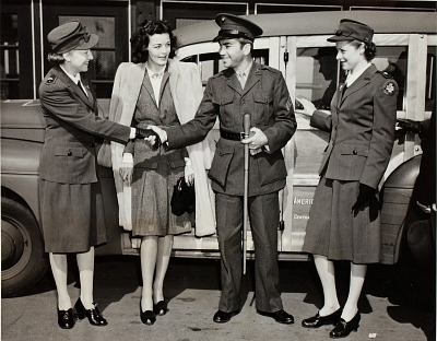 Barney Ross (center) as Marine Corporal and wife flanked by Lt. Anne Draffer (left) and Lt. Frances Alpert (right) from the American Red Cross